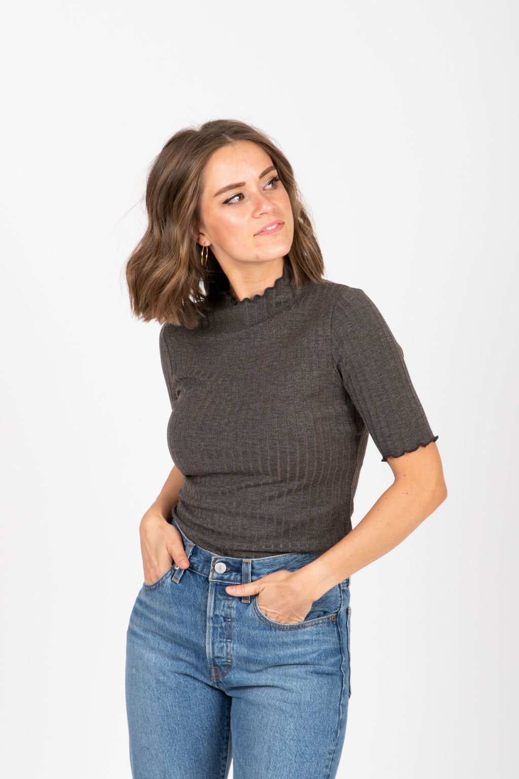 The Allistair Ribbed Casual Mock Neck Blouse in Charcoal, studio shoot; front view