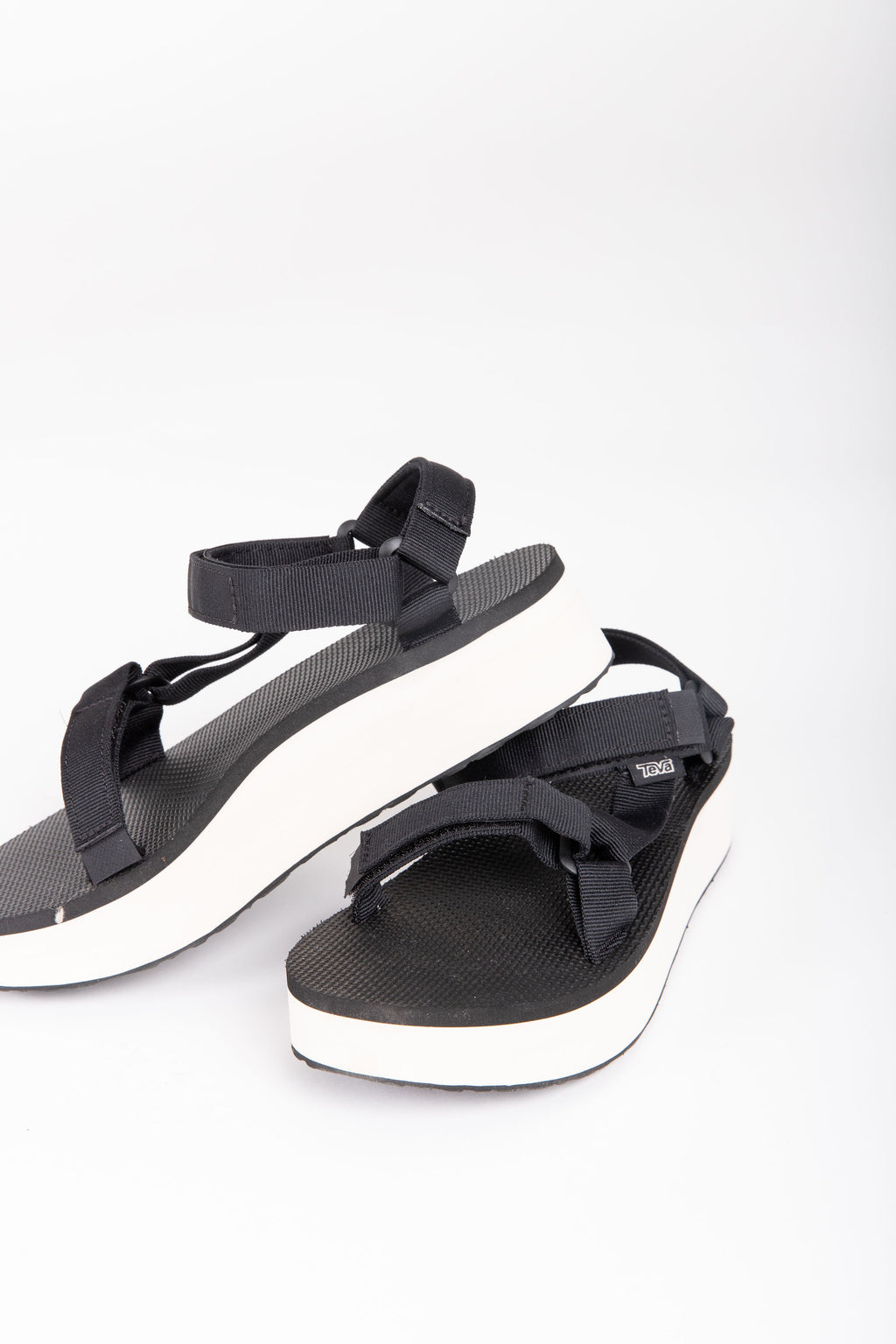 Teva: Flatform Universal in Black + Tan