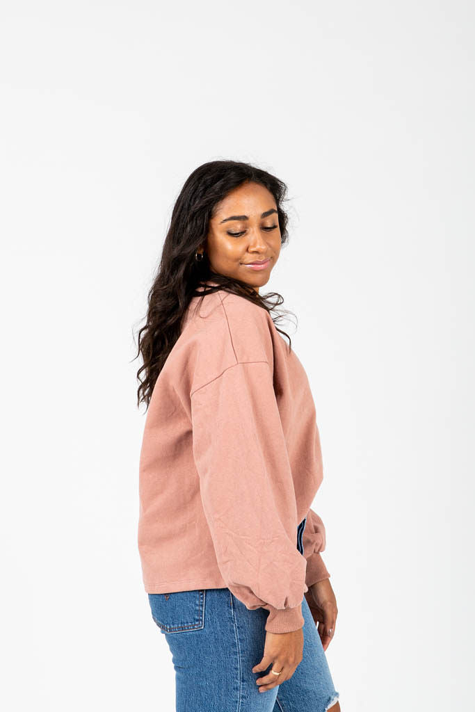 The Grint Balloon Sleeve Pullover in Mauve, studio shoot; side view