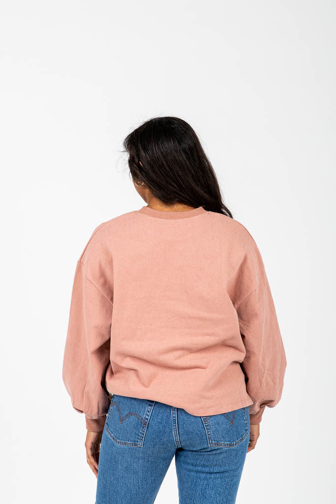 The Grint Balloon Sleeve Pullover in Mauve, studio shoot; back view