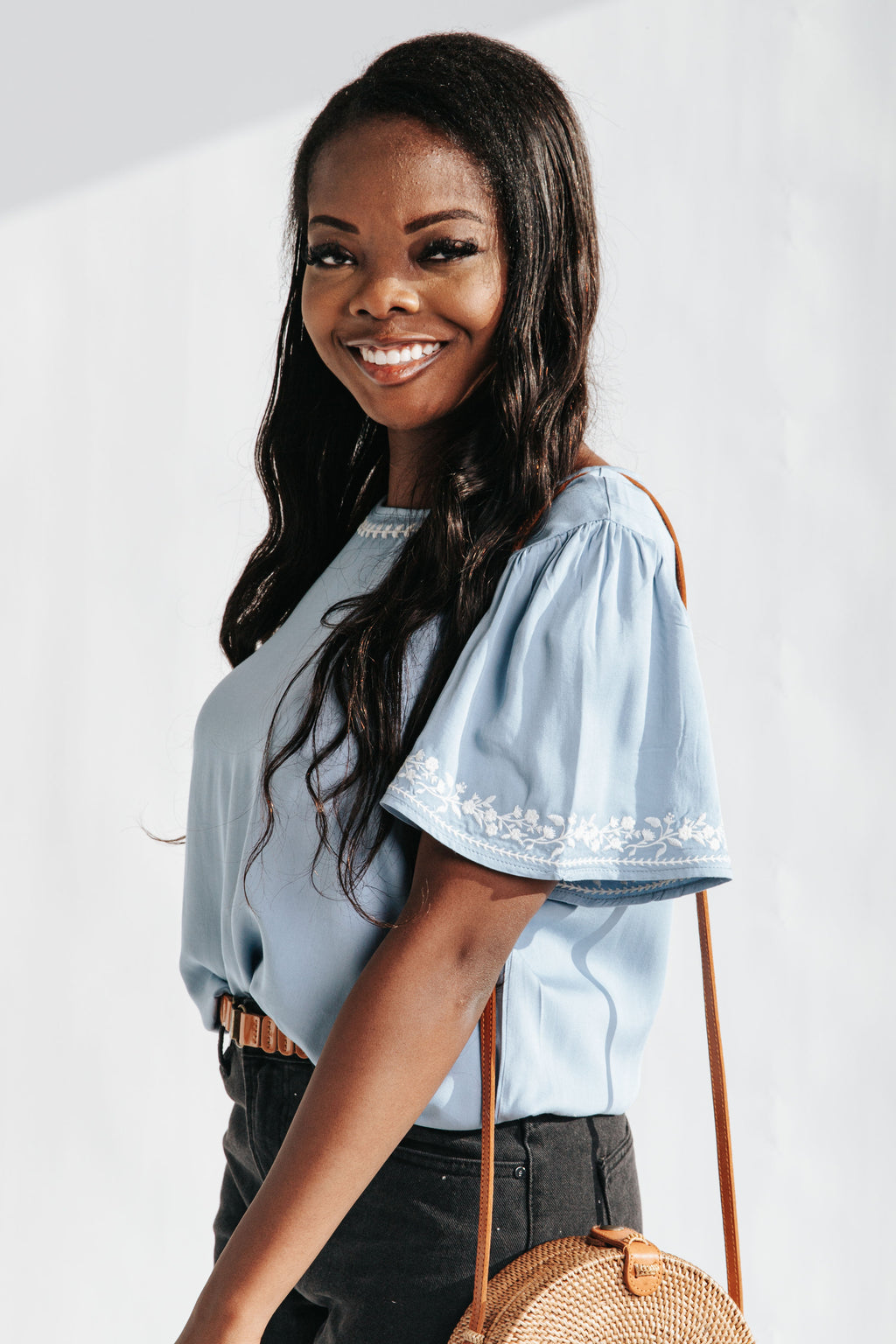 The Rhett Embroidered Detail Blouse in Baby Blue, studio shoot; side view