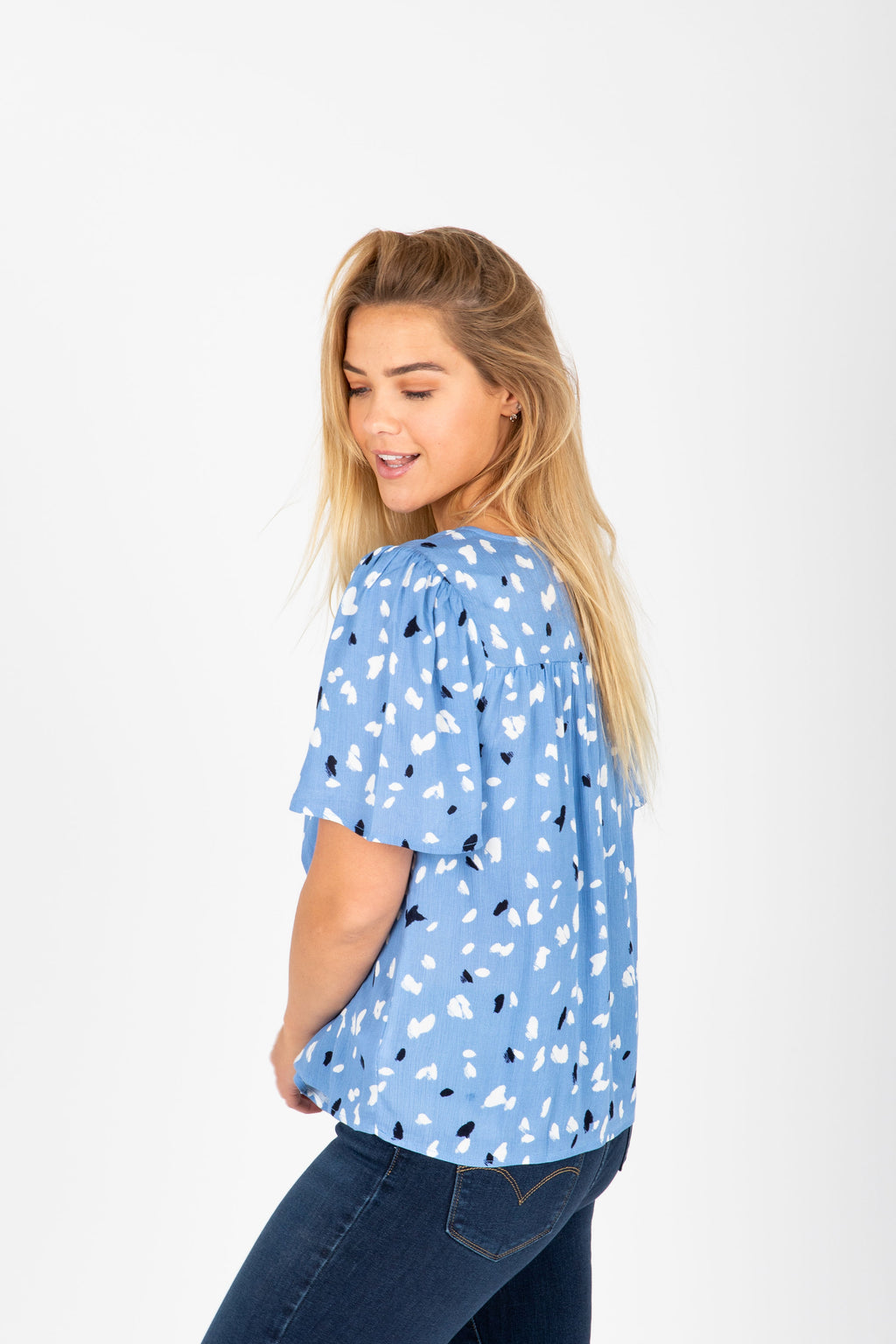 The Jolene Patterned Detail Blouse in Periwinkle, studio shoot; side view
