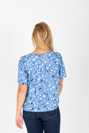 The Jolene Patterned Detail Blouse in Periwinkle, studio shoot; back view