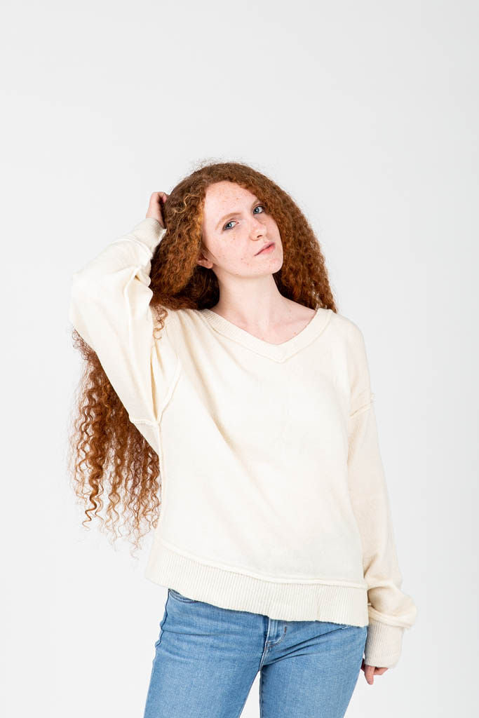 The Wynn Cozy V-Neck Pullover in Cream, studio shoot; front view
