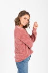 The Bradley Cozy Mock Neck Sweater in Rose, studio shoot; side view
