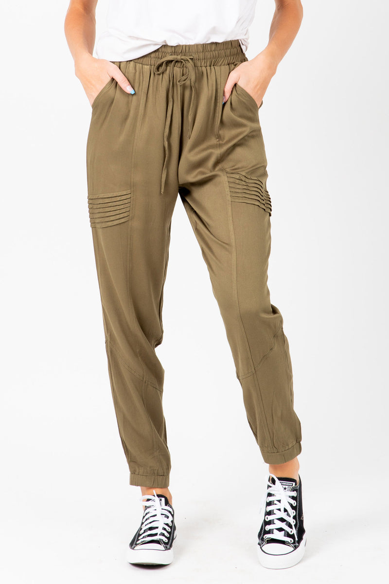 The Newell Detail Jogger Trouser in Olive, studio shoot; front view