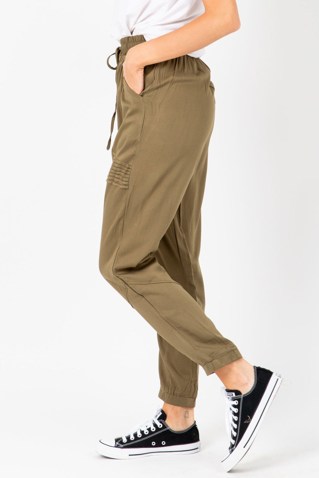 The Newell Detail Jogger Trouser in Olive, studio shoot; side view