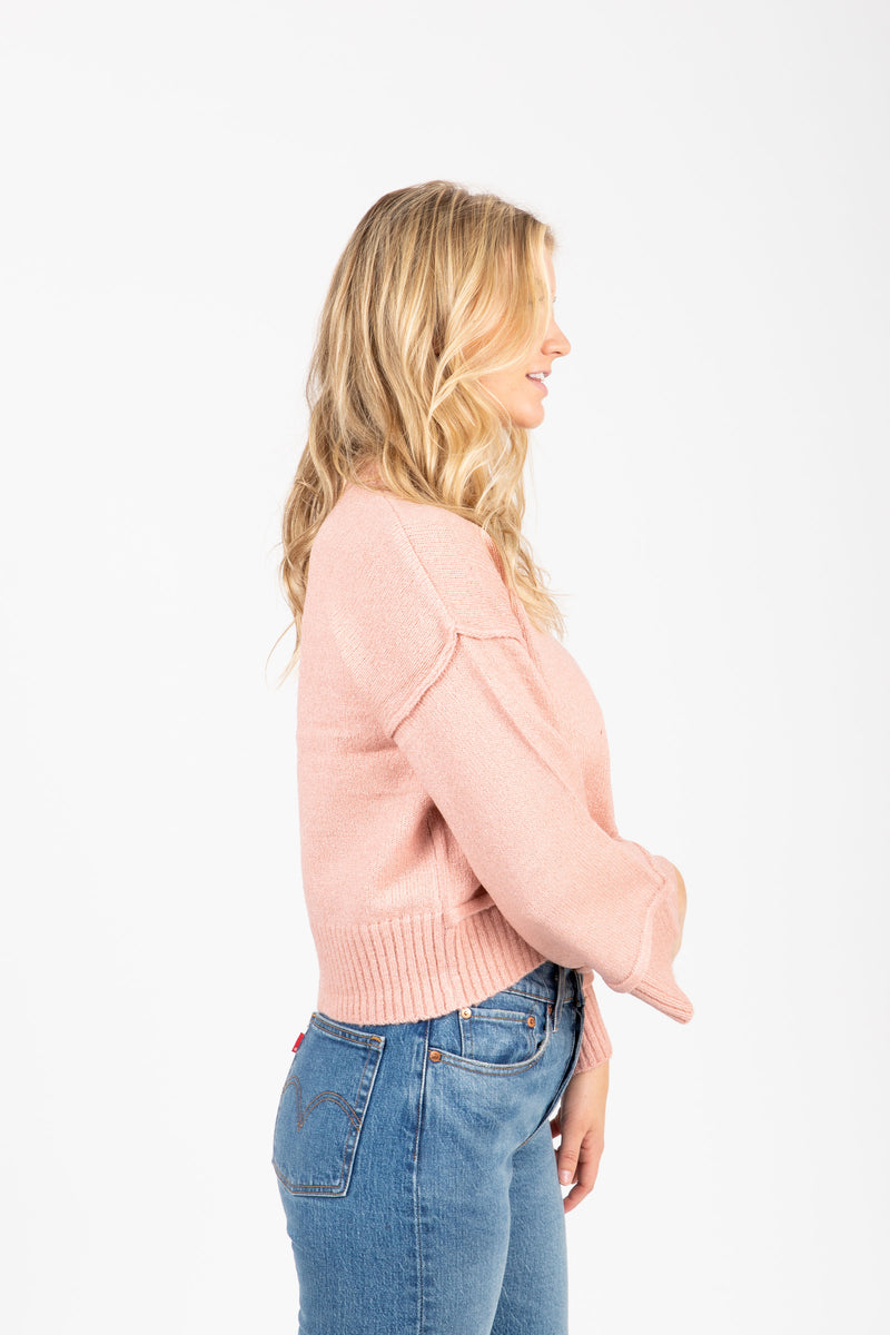The Neat Ribbed Trim Sweater in Dusty Pink, studio shoot; side view