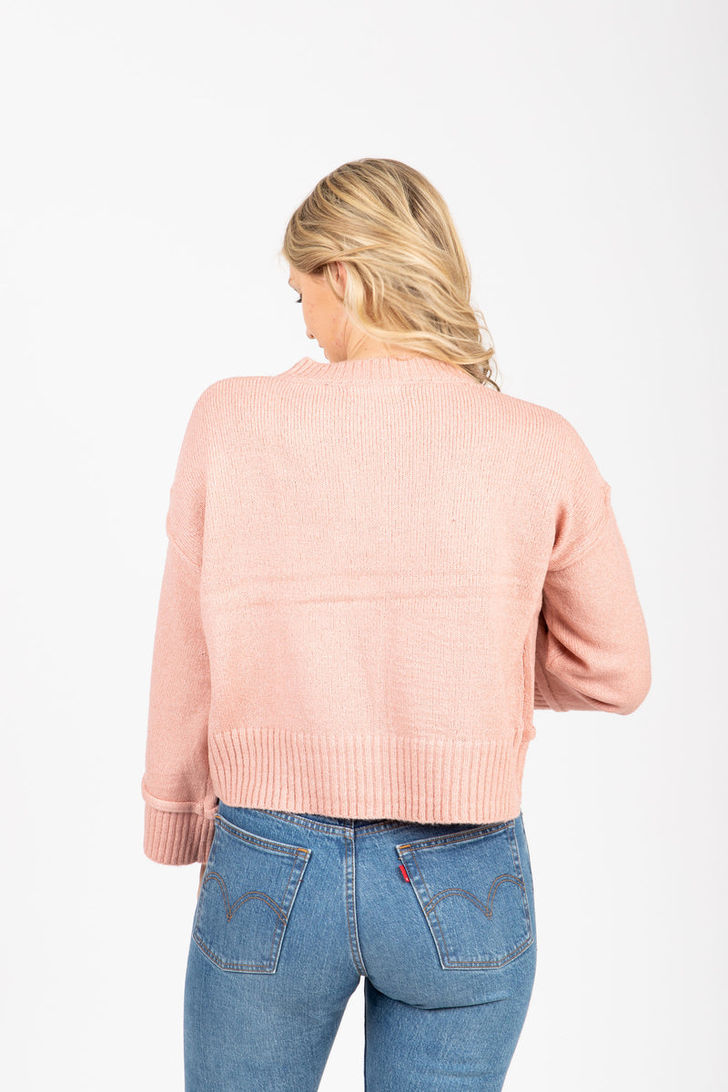 The Neat Ribbed Trim Sweater in Dusty Pink, studio shoot; back view