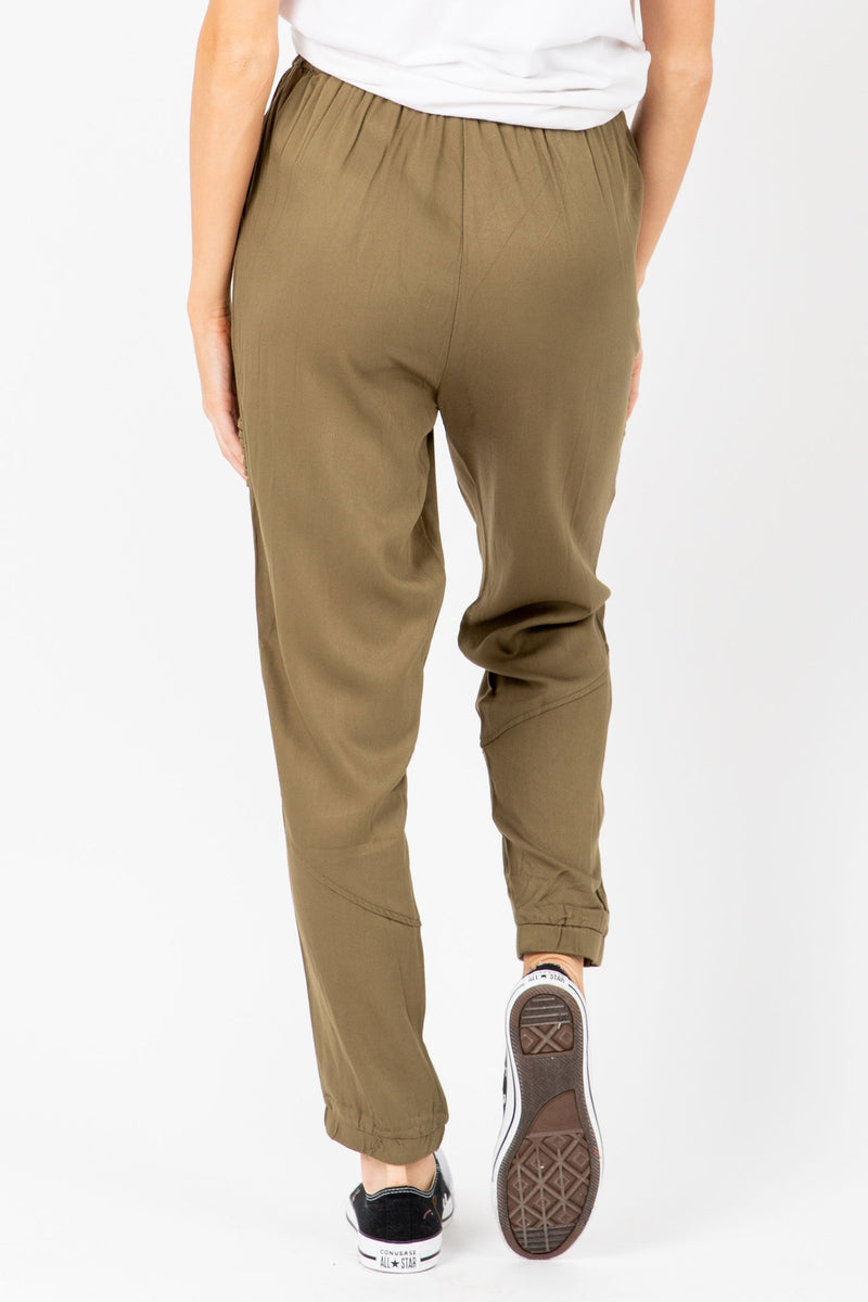 The Newell Detail Jogger Trouser in Olive, studio shoot; back view