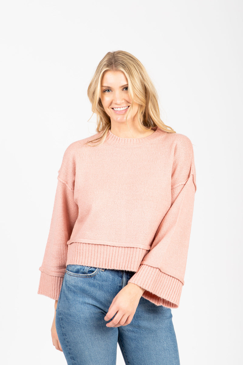 The Neat Ribbed Trim Sweater in Dusty Pink, studio shoot; front view