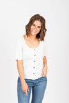 The Noa Ribbed Henley in Ivory, studio shoot; front view