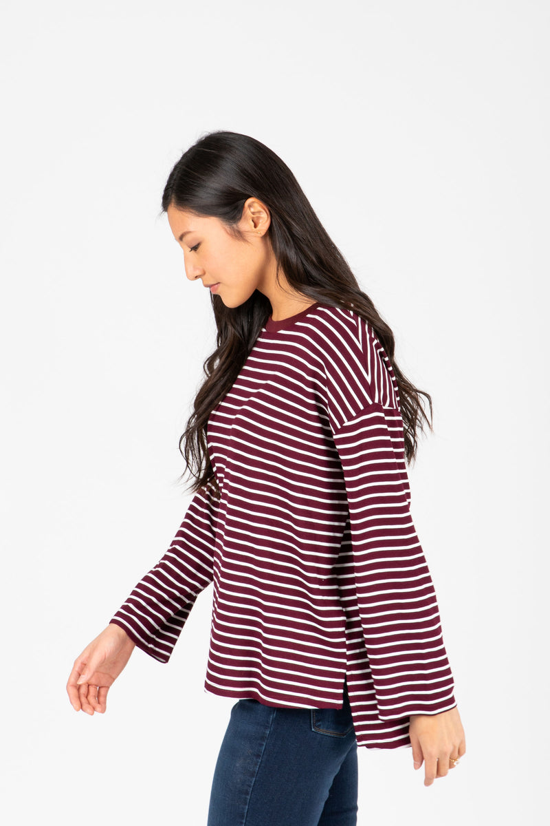 The Arthur Striped Tee in Burgundy, studio shoot; side view
