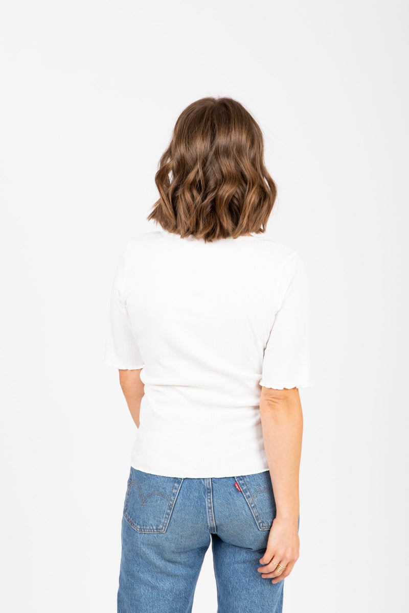 The Noa Ribbed Henley in Ivory, studio shoot; back view
