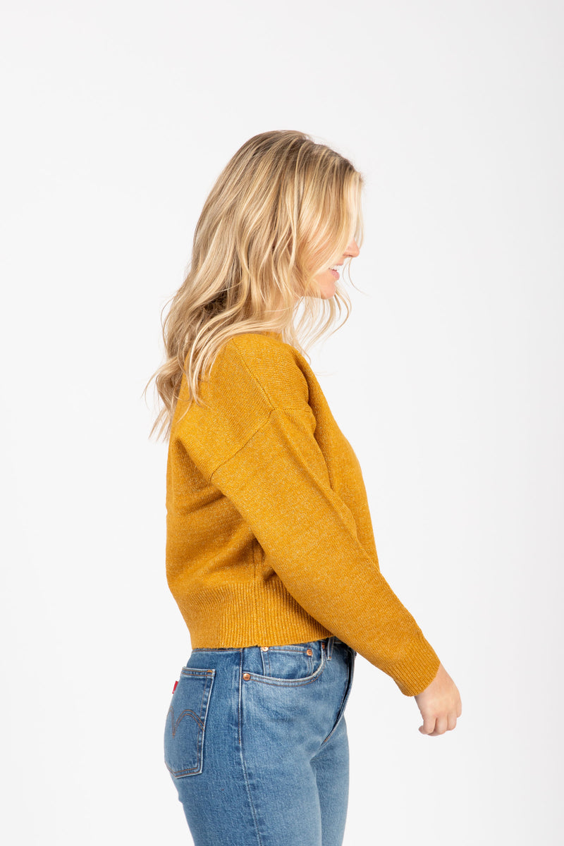 The Street Casual Sweater in Mustard, studio shoot; side view