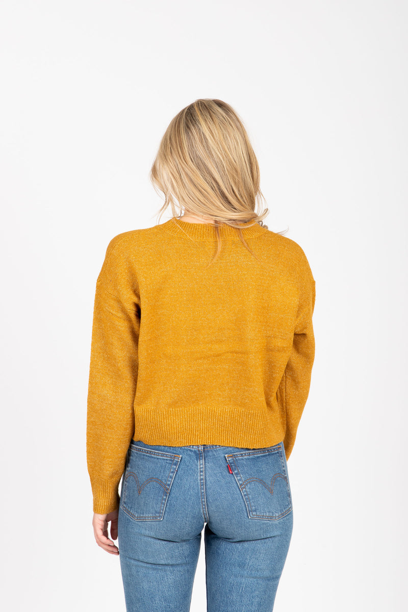 The Street Casual Sweater in Mustard, studio shoot; back view