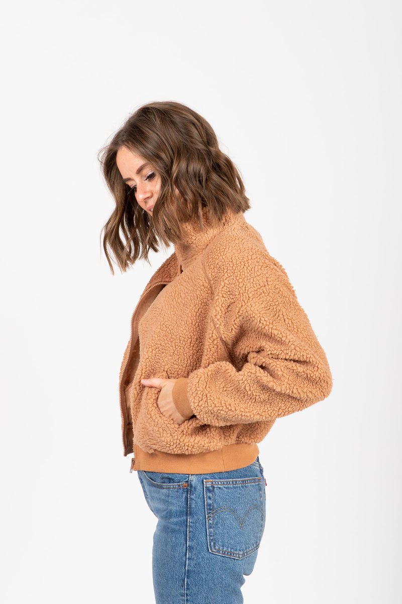The Core Teddy Jacket in Tan, studio shoot; side view