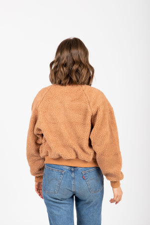 The Core Teddy Jacket in Tan, studio shoot; back view