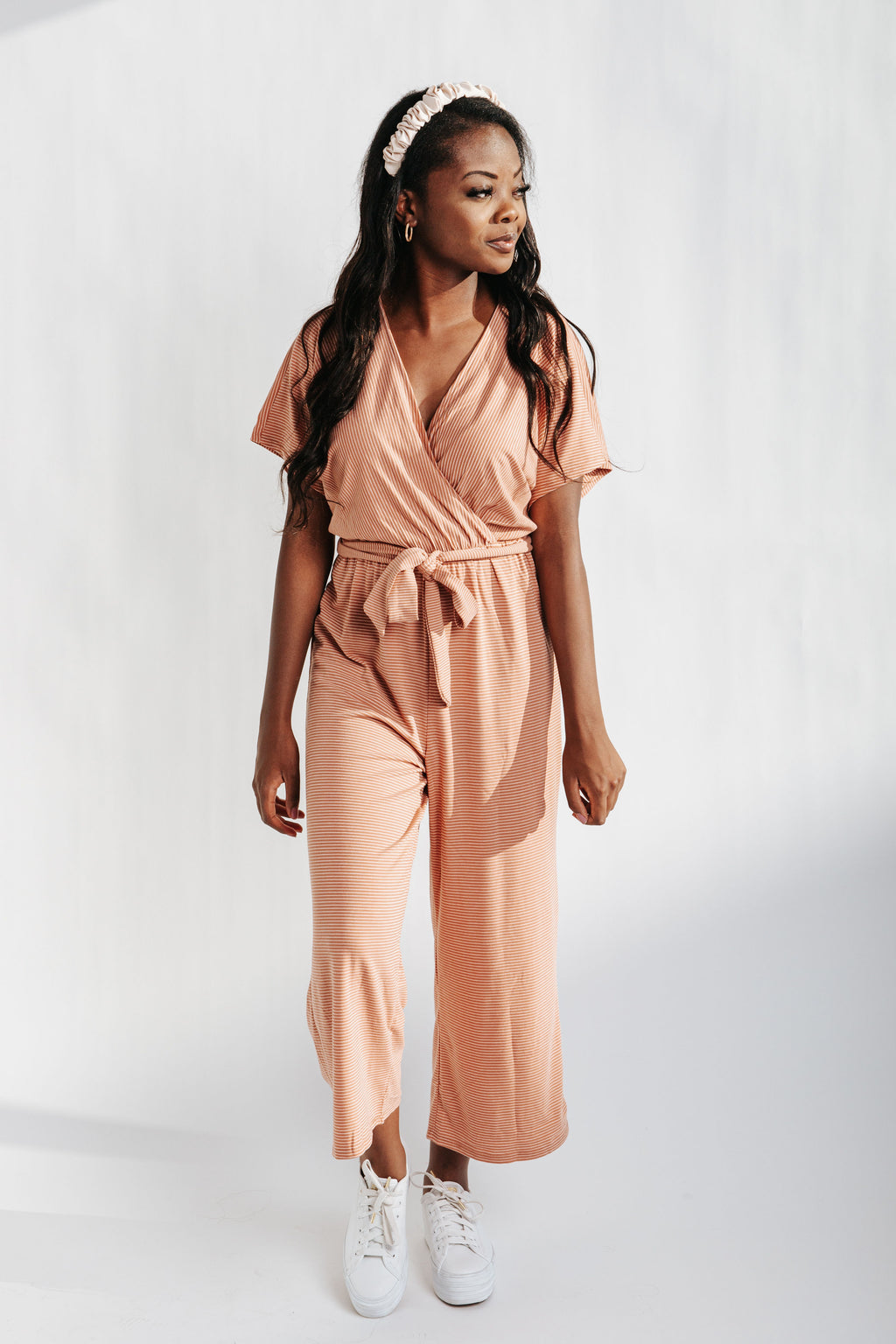 The Landers Striped Jumpsuit in Clay, studio shoot; front view