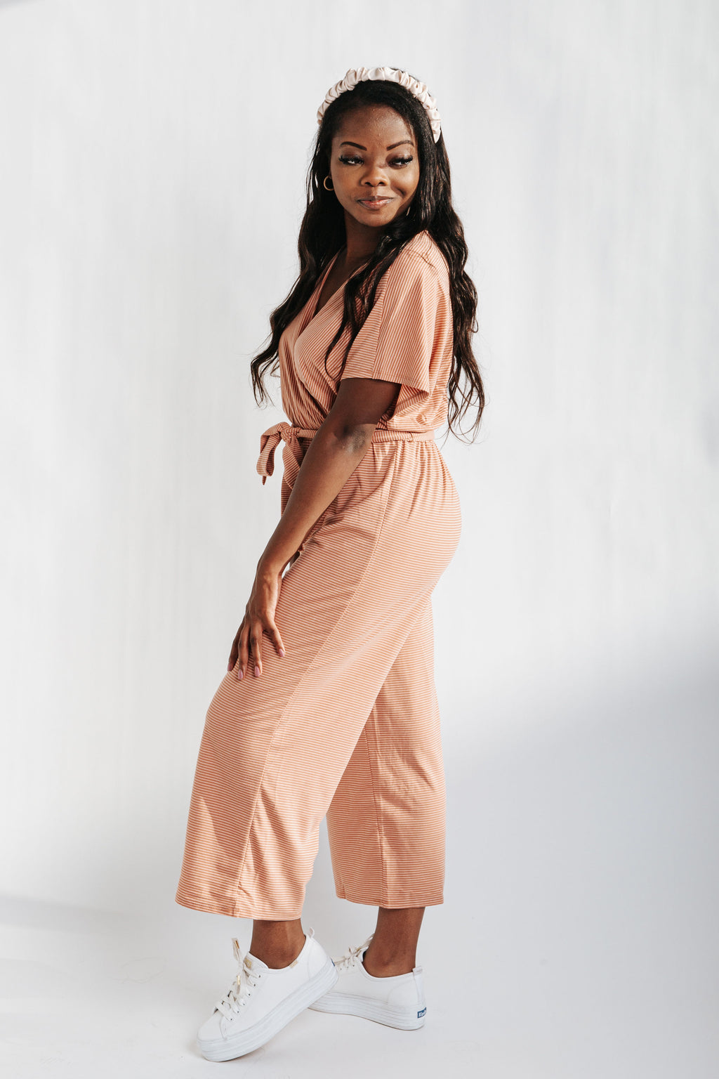 The Landers Striped Jumpsuit in Clay, studio shoot; side view