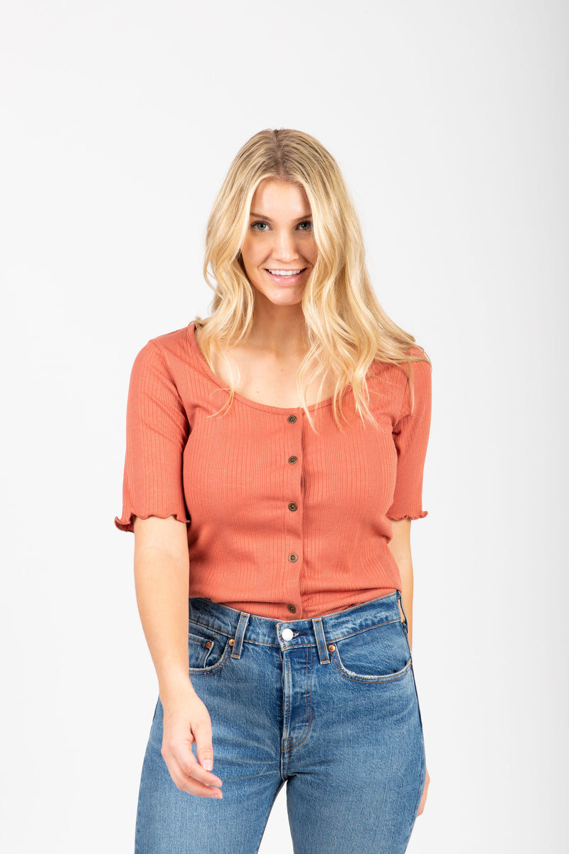 The Noa Ribbed Henley in Rust, studio shoot; front view