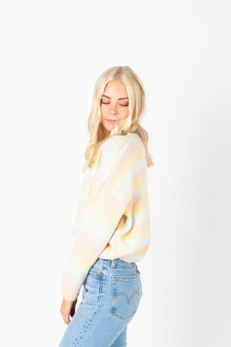 The Estelle Cozy Knit in Pastel, studio shoot; side view
