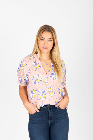 The Kyla Floral Button Blouse in Blush, studio shoot; front view