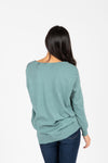The Brant V-Neck Sweater in Teal, studio shoot; back view
