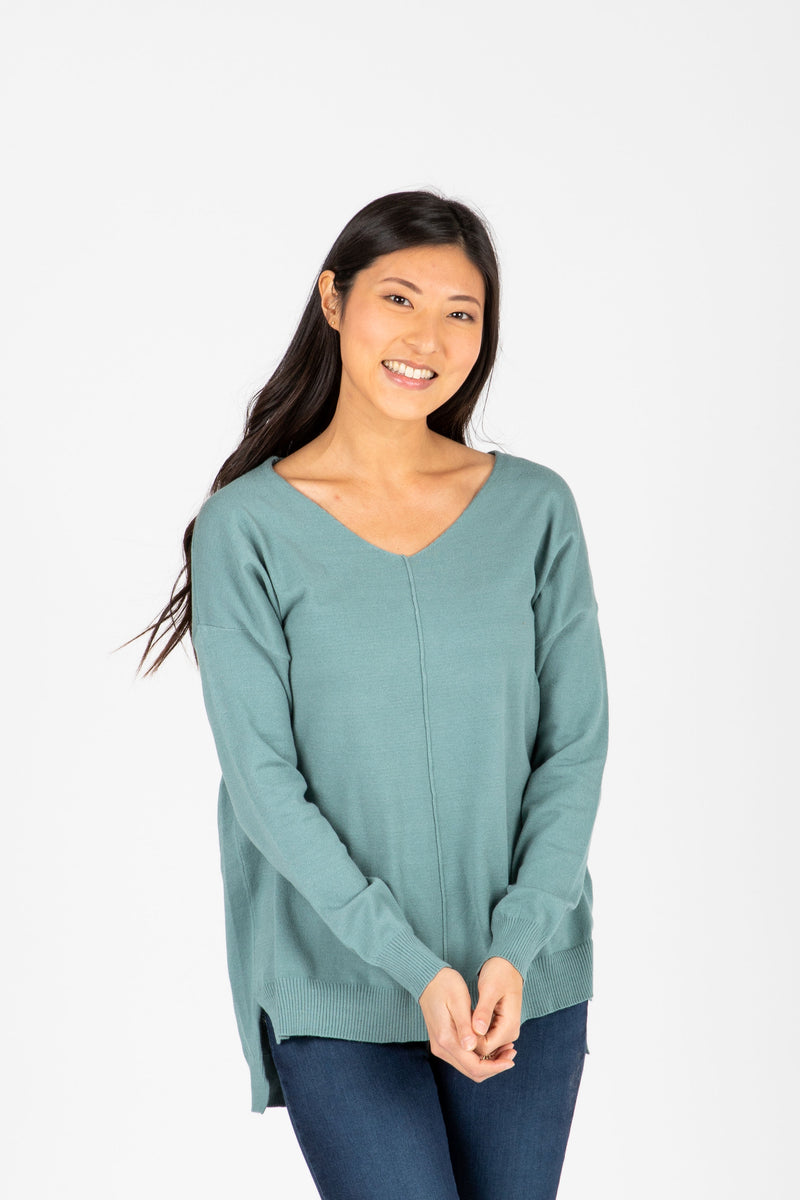 The Brant V-Neck Sweater in Teal, studio shoot; front view