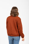 The Victor Quilted Bomber Jacket in Brick, studio shoot; back view