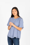 The Minta Swiss Dot Blouse in Sky, studio shoot; front view