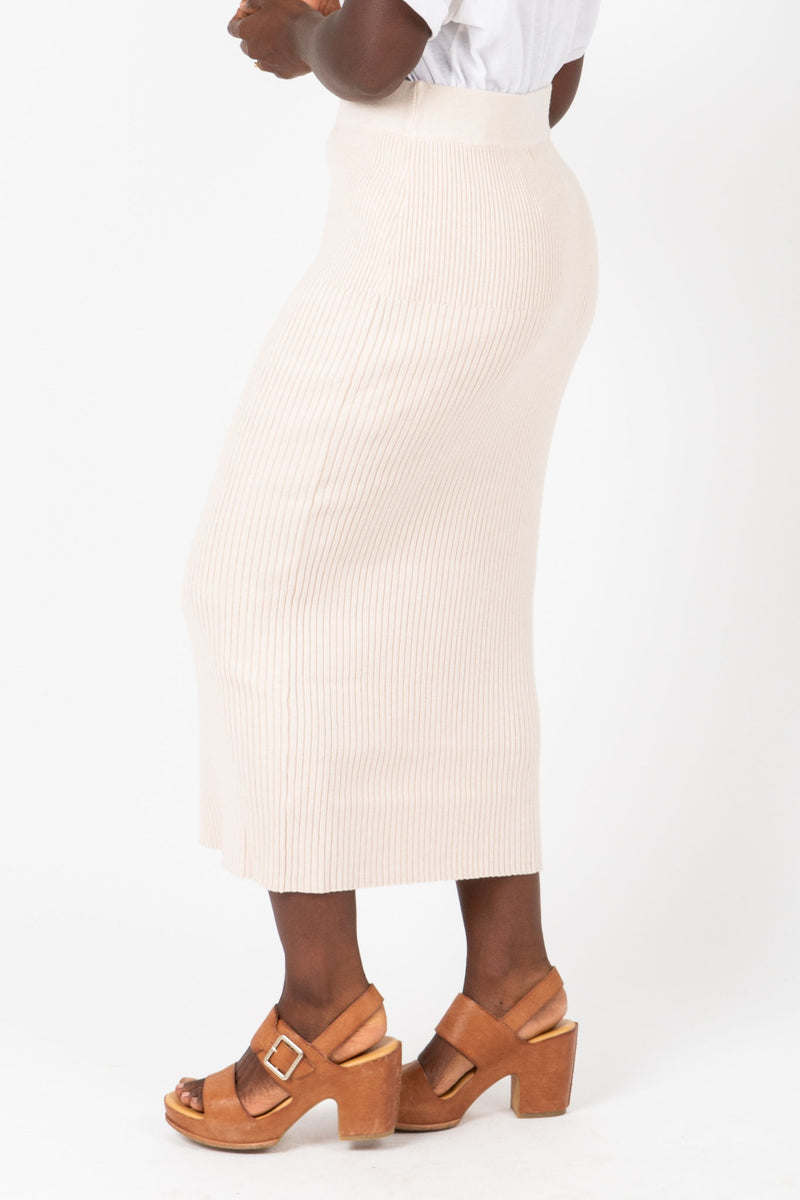 The Reynolds Ribbed Knit Skirt in Ivory, studio shoot; side view