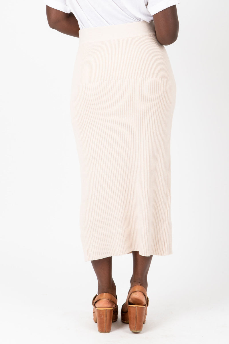 The Reynolds Ribbed Knit Skirt in Ivory, studio shoot; back view
