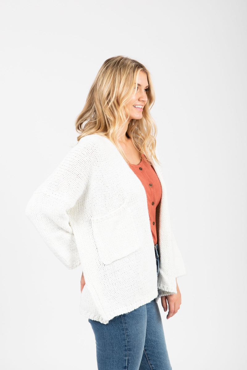 The Soul Pocket Knit Cardigan in Ivory, studio shoot; side view