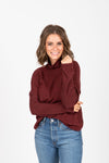 The Starling Soft Mock Neck Blouse in Burgundy, studio shoot; front view