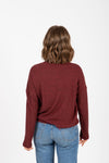 The Starling Soft Mock Neck Blouse in Burgundy, studio shoot; back view