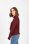The Starling Soft Mock Neck Blouse in Burgundy, studio shoot; side view