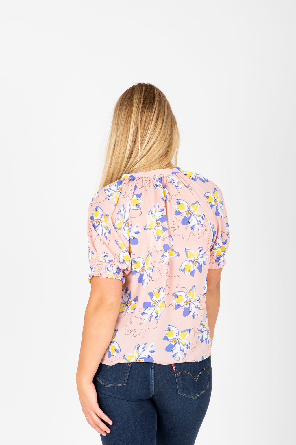 The Kyla Floral Button Blouse in Blush, studio shoot; back view