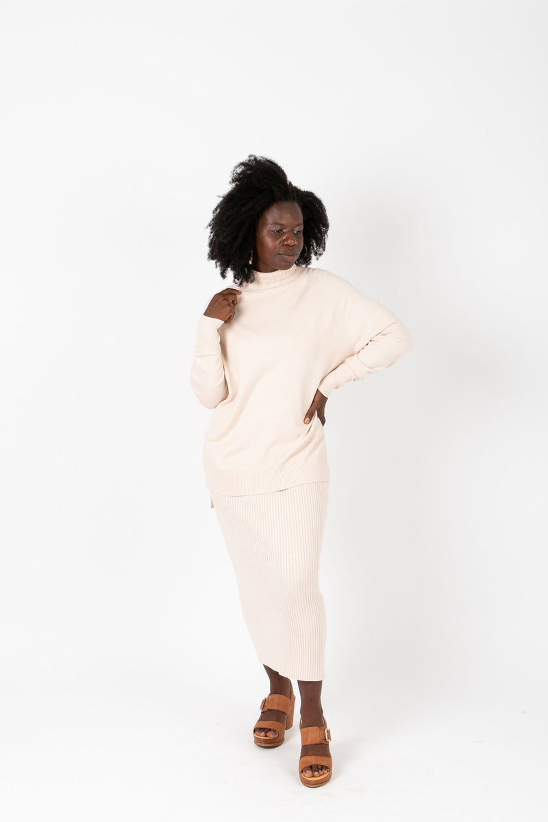 The Reynolds Ribbed Knit Skirt in Ivory, studio shoot; front view