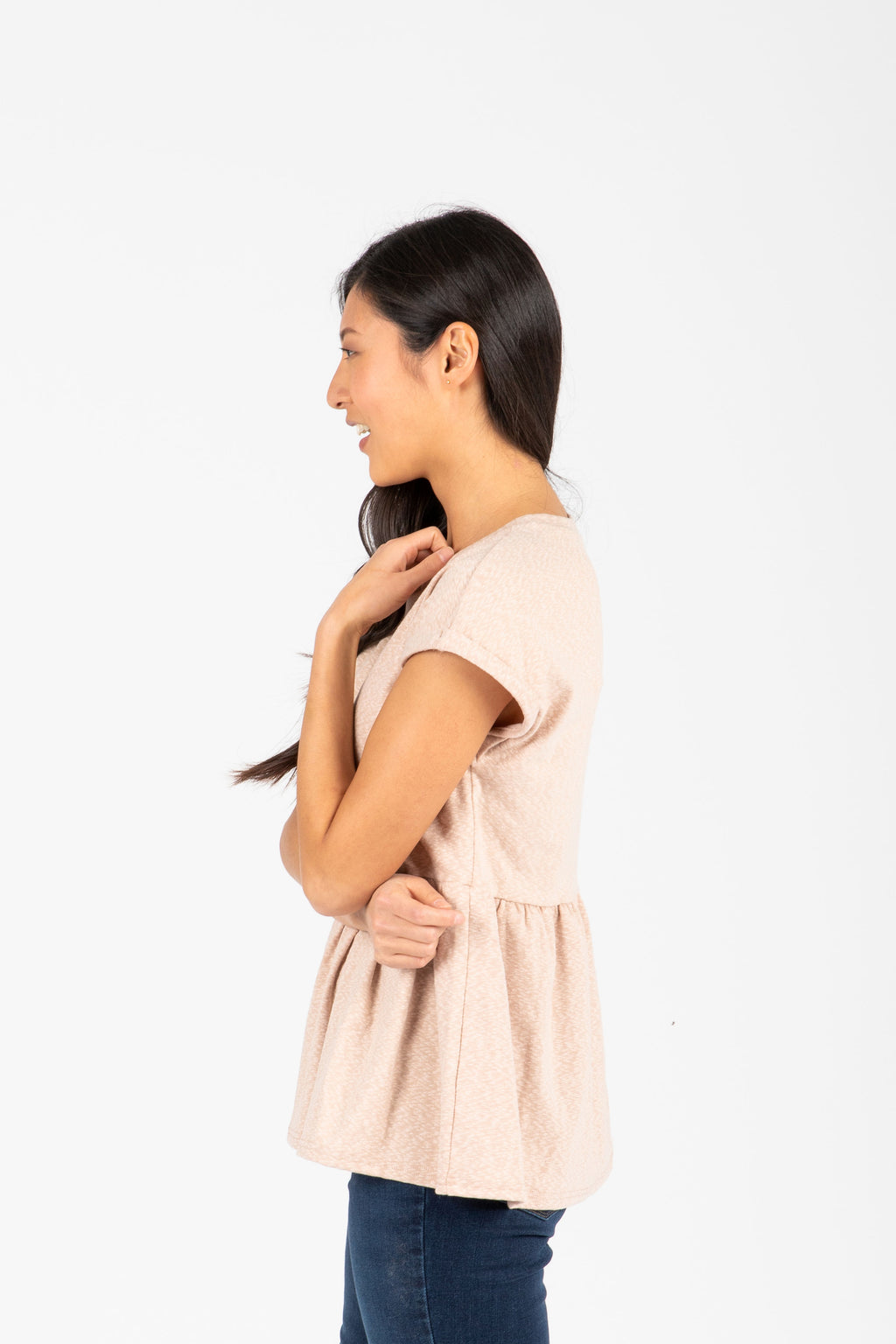 The Bethan Casual Heathered Peplum Blouse in Natural, studio shoot; side view