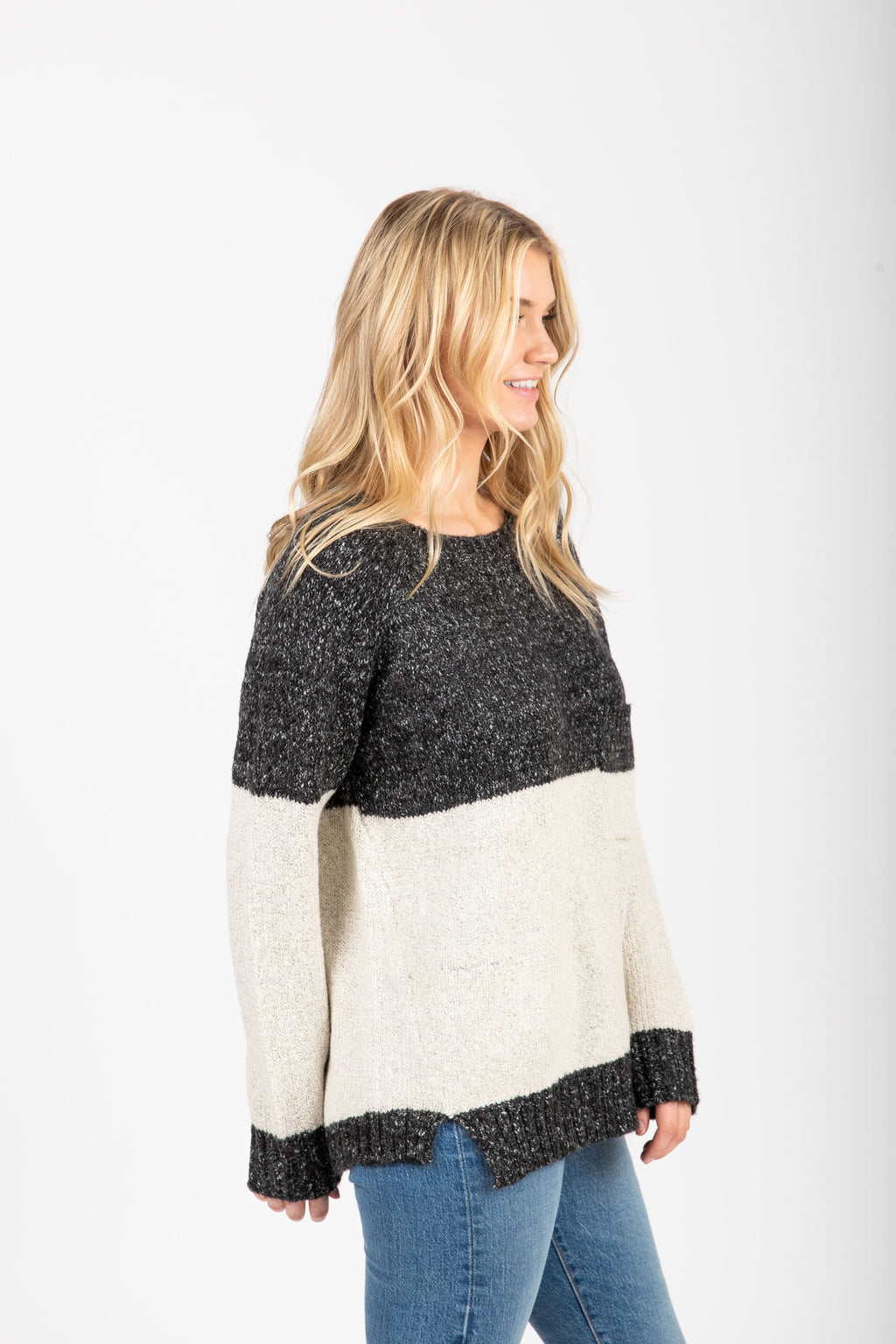 The Avenue Sweater in Black, studio shoot; side view