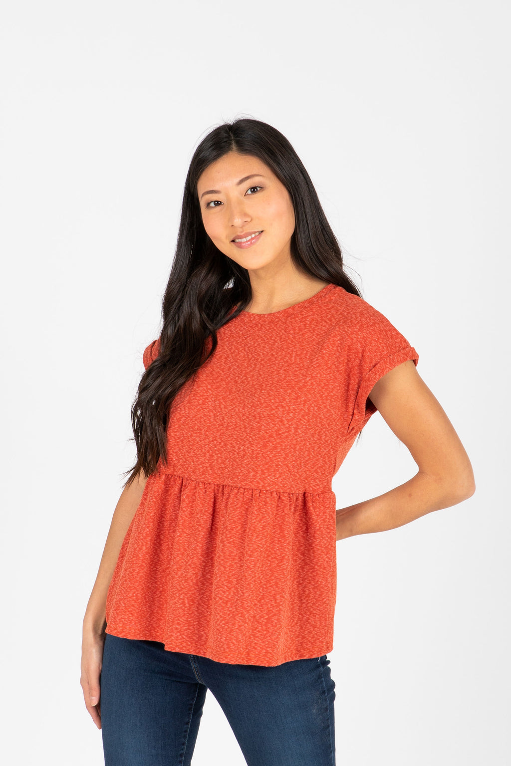 The Bethan Casual Heathered Peplum Blouse in Poppy, studio shoot; front view