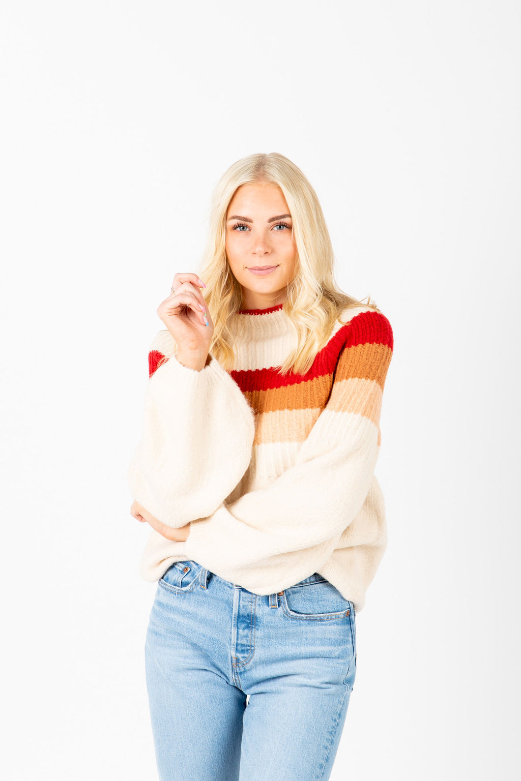 The Erskine Striped Mock Neck Knit in Red, studio shoot; front view