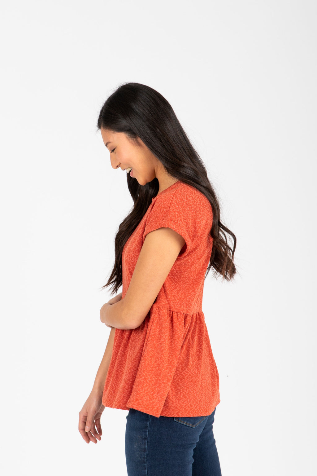 The Bethan Casual Heathered Peplum Blouse in Poppy, studio shoot; side view