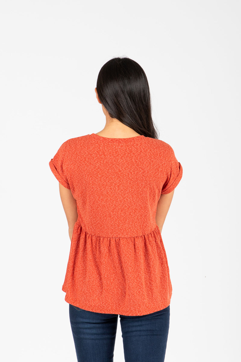 The Bethan Casual Heathered Peplum Blouse in Poppy, studio shoot; back view