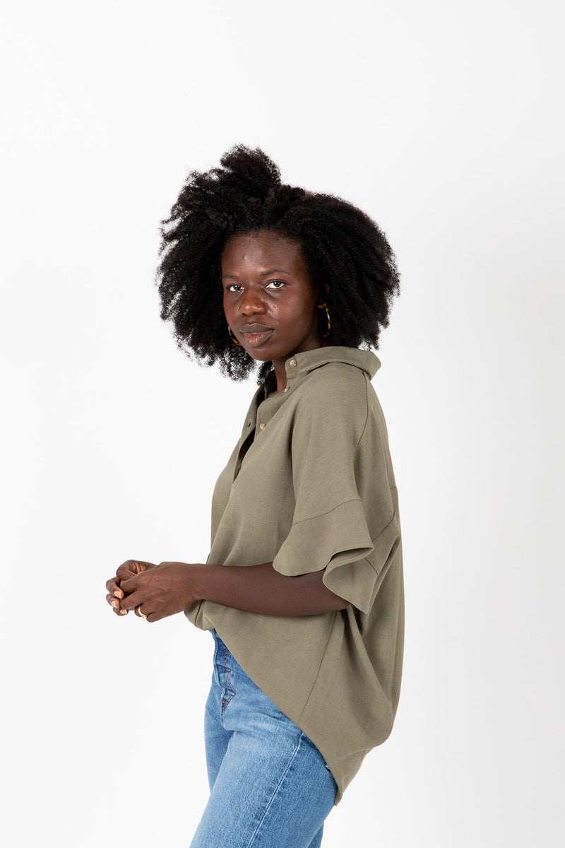 The Audrey Button Blouse in Sage, studio shoot; side view