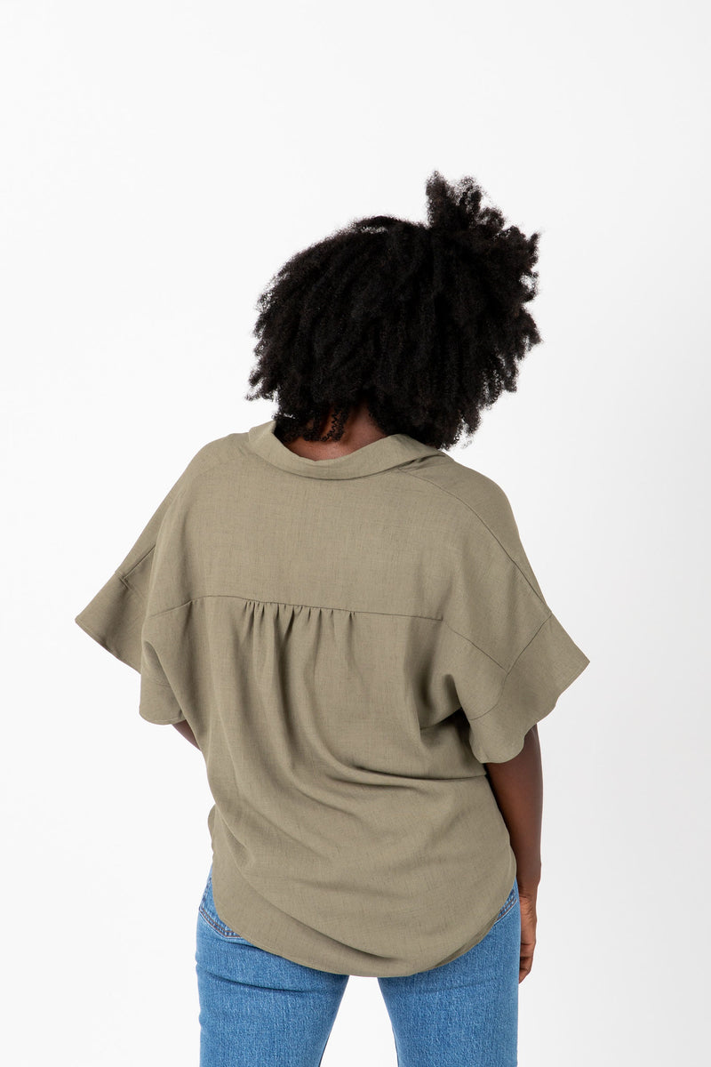 The Audrey Button Blouse in Sage, studio shoot; back view