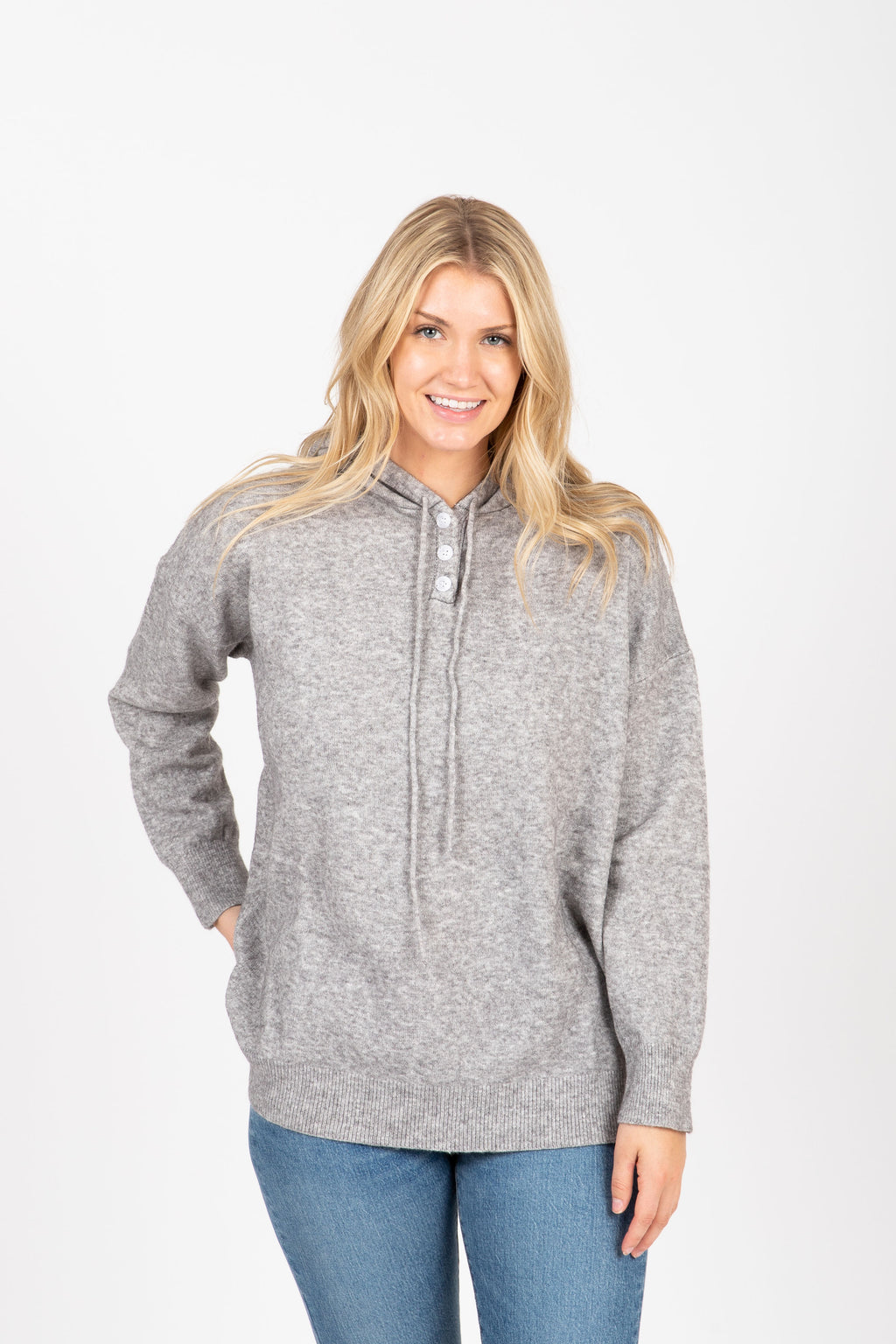 The Farnese Hooded Cozy Sweater in Heather Grey, studio shoot; front view