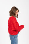 The Form Casual Sweater Blouse in Red, studio shoot; side view