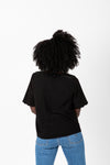 The Naya Scalloped Button Blouse in Black, studio shoot; back view